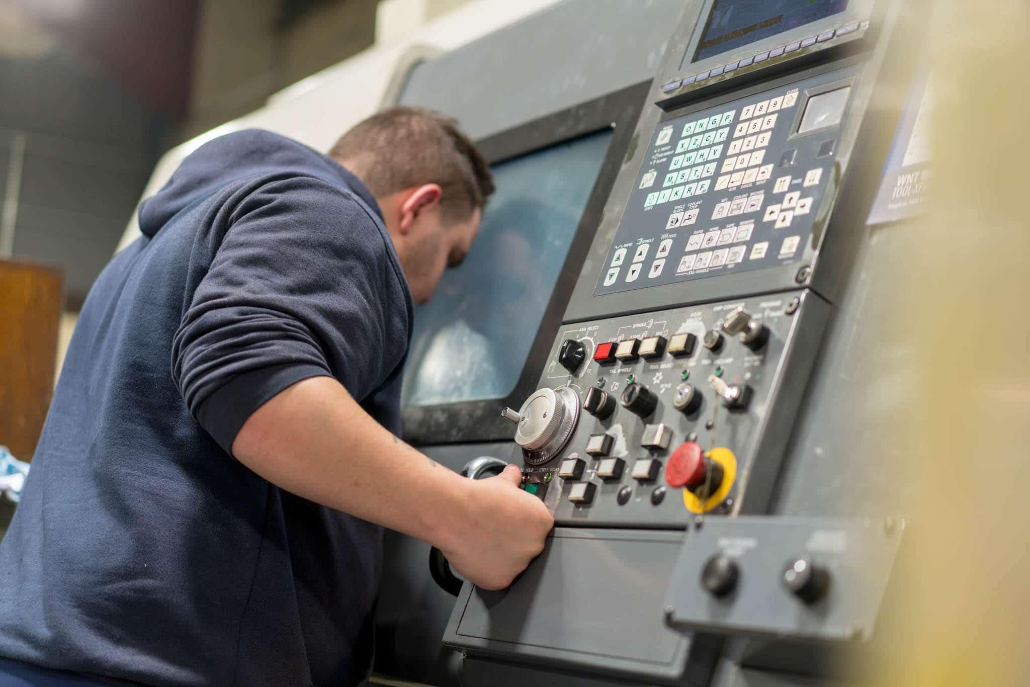 Man looking at machinery