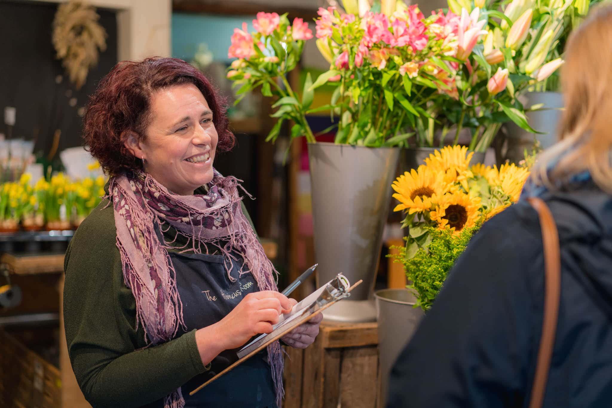florist smiling at customer