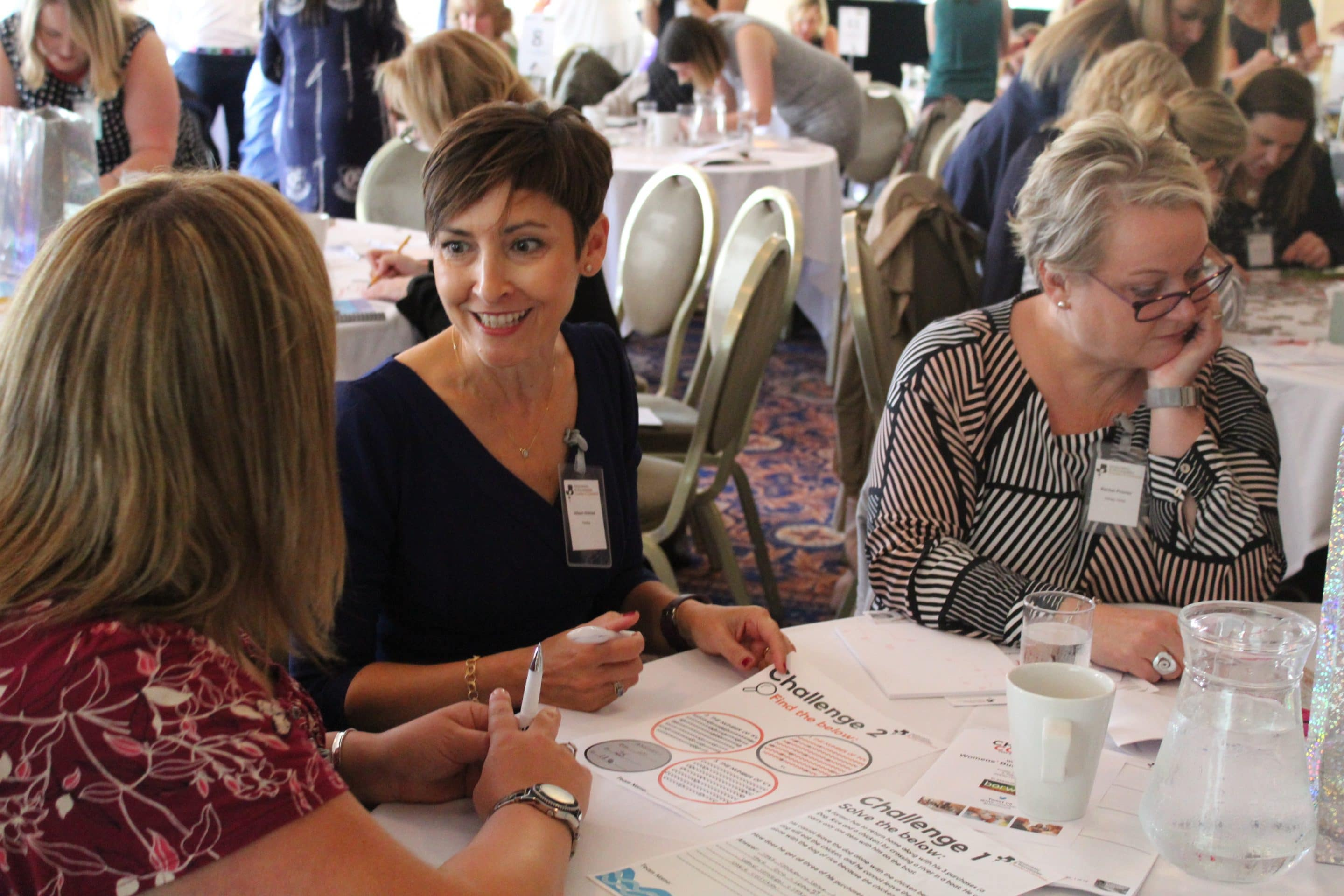 women sat around a table at a networking event