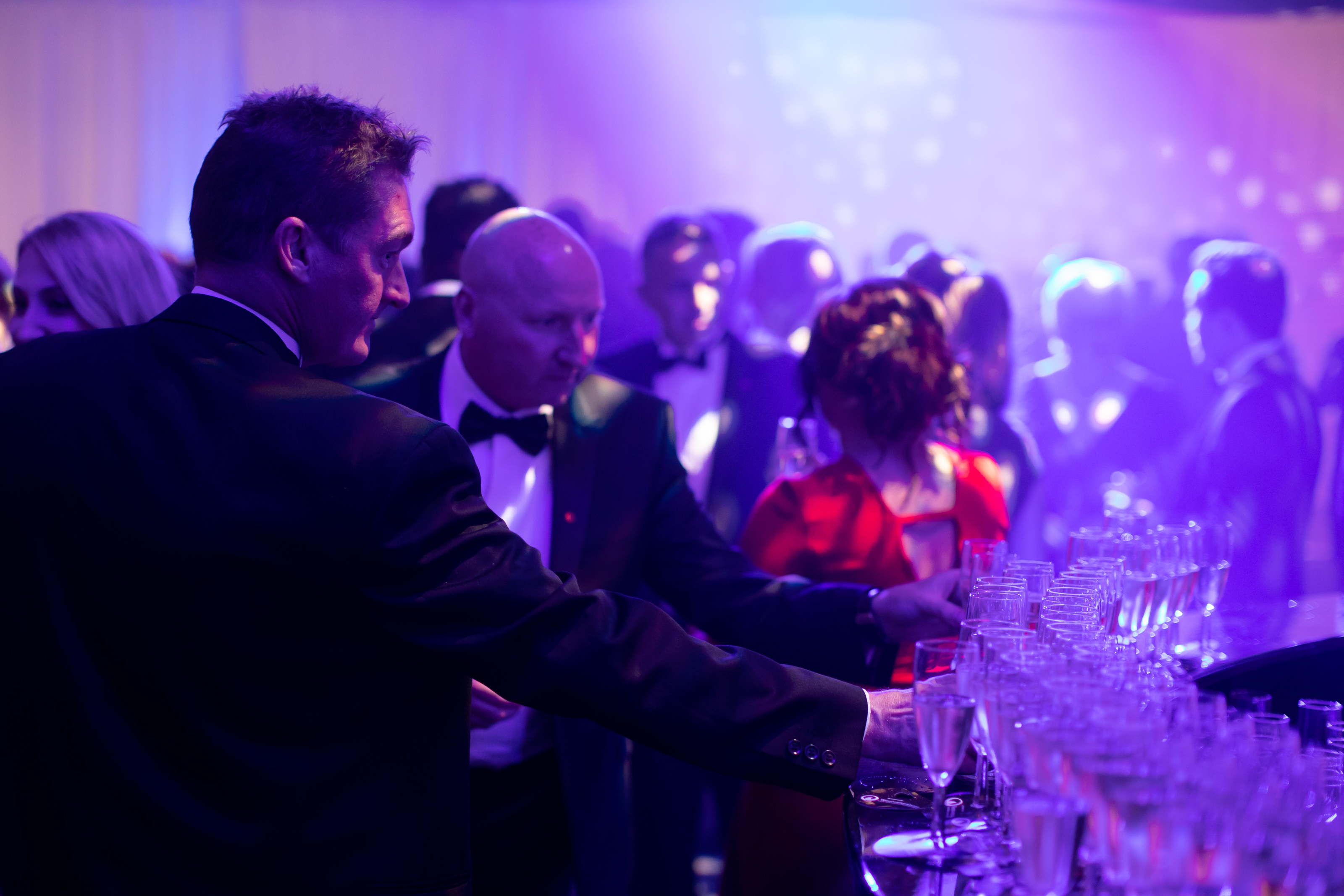 chamber business awards event sponsorship people picking up drinks