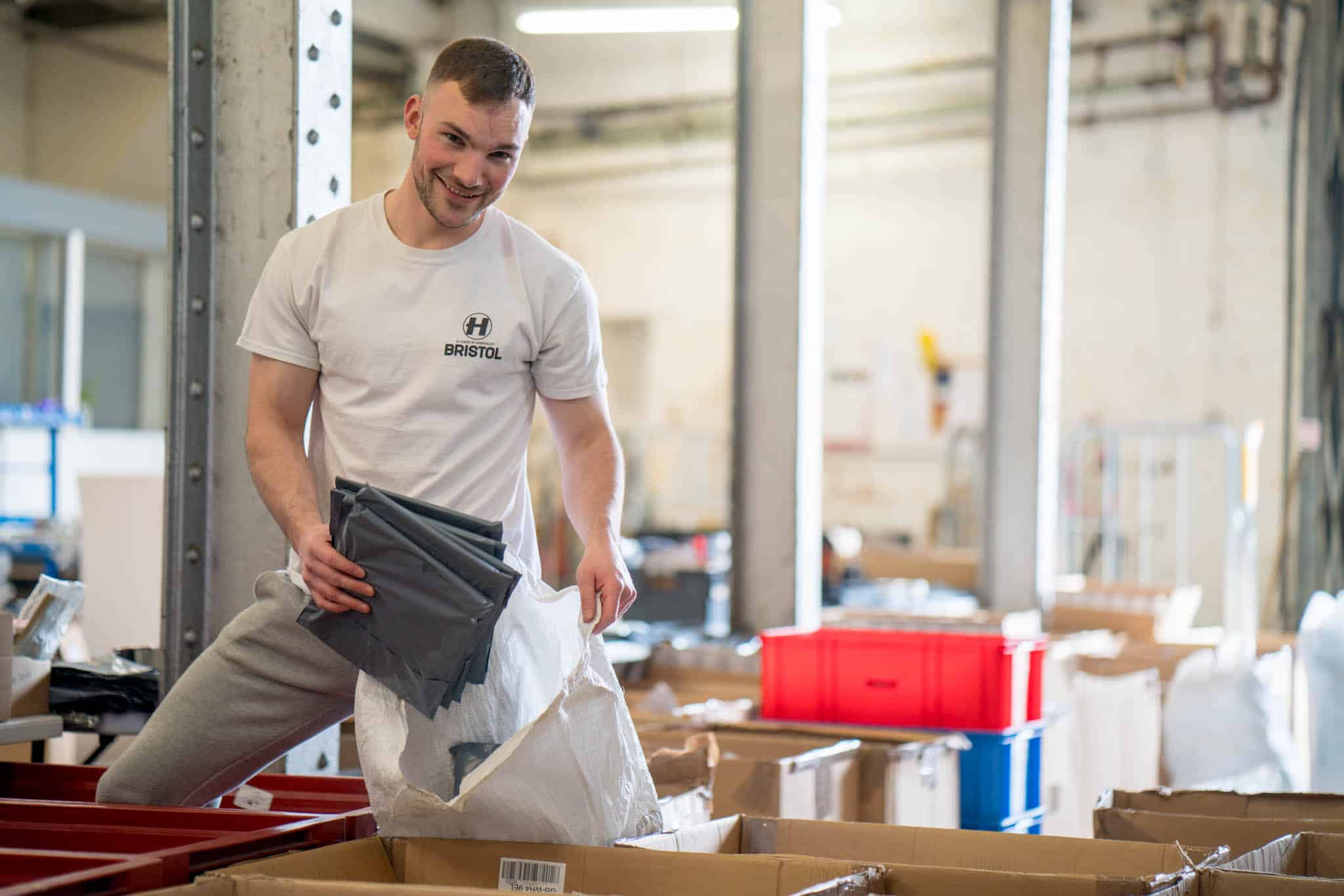 Chamber of Commerce membership business, man filling bag with parcels