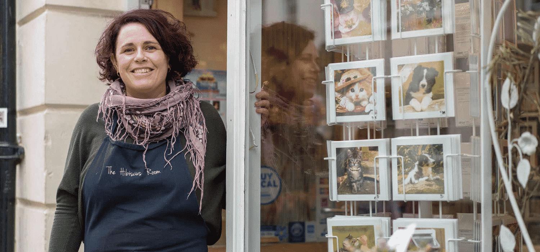 Coronavirus business support woman stood at doorway