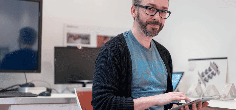 Man looking at Coronavirus business support advice on ipad