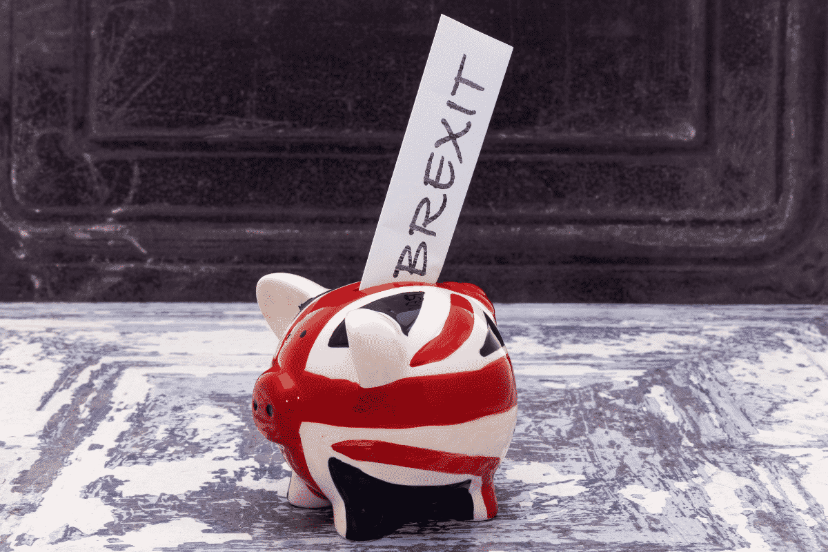eu exit ceramic union jack pig money box with brexit written on paper sticking out